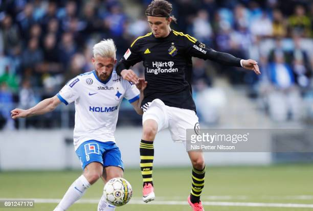 Nicklas Barkroth of IFK Norrkoping and Kristoffer Olsson of AIK competes for the ball during the Allsvenskan match between AIK and IFK Norrkoping at...