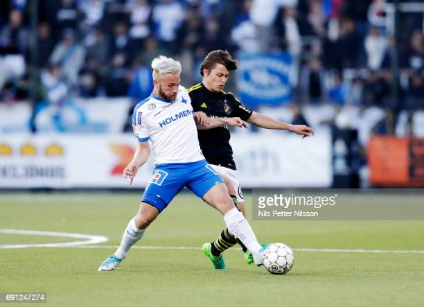 Nicklas Barkroth of IFK Norrkoping and Simon Thern of AIK competes for the ball during the Allsvenskan match between AIK and IFK Norrkoping at...