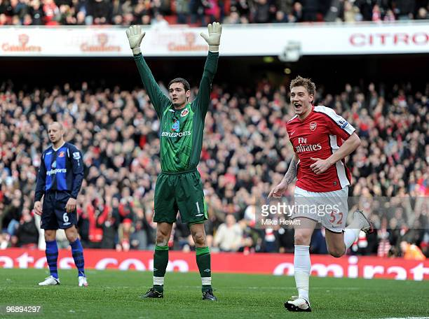 Nicklas Bendtner of Arsenal celebrates his tap in as Craig Gordon of Sunderland appeals for offside during the Barclays Premiere League match between...