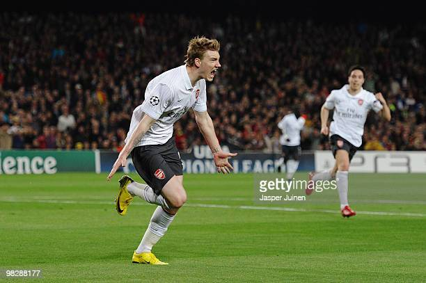Nicklas Bendtner of Arsenal celebrates scoring the opening goal during the UEFA Champions League quarter final second leg match between Barcelona and...