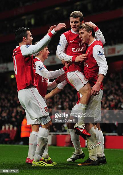 Nicklas Bendtner of Arsenal celebrates with team mates as he scores their first goal during the Carling Cup Semi Final Second Leg match between...