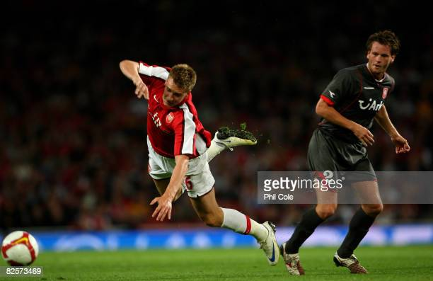 Nicklas Bendtner of Arsenal gets tackled by Robbi Wielaert of FC Twente during the UEFA Champions League third qualifying round, second leg match...