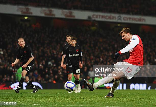 Nicklas Bendtner of Arsenal scores from the penalty spot to complete his hat trick during the FA Cup sponsored by EON 5th Round Replay match between...