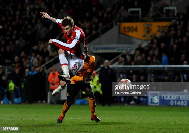 Nicklas Bendtner of Arsenal scores the 2nd goal during the Barclays Premier League match between Hull City and Arsenal at KC Stadium on March 13,...