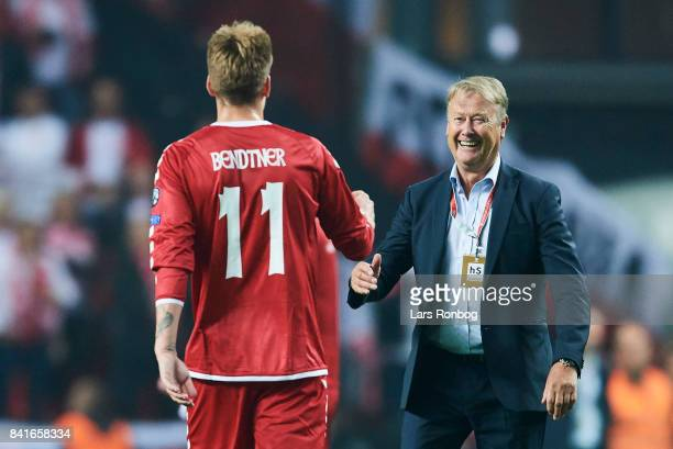 Nicklas Bendtner of Denmark and Age Hareide head coach of Denmark celebrate after the FIFA World Cup 2018 qualifier match between Denmark and Poland...