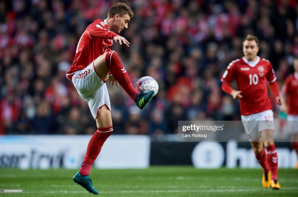 Nicklas Bendtner of Denmark and Christian Eriksen of Denmark in action during the FIFA World Cup 2018 qualifier match between Denmark and Romania at Telia Parken Stadium on October 8, 2017 in Copenhagen, Denmark.