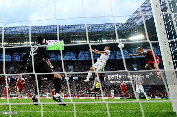 Nicklas Bendtner of Denmark beats Pepe of Portugal to head in their second goal during the UEFA EURO 2012 group B match between Denmark and Portugal...