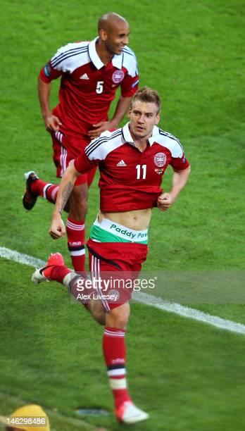 L'VIV UKRAINE JUNE 13 Nicklas Bendtner of Denmark celebrates scoring their second goal during the UEFA EURO 2012 group B match between Denmark and...