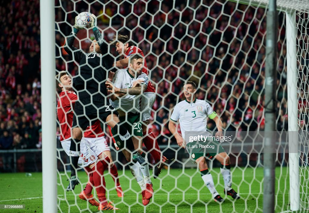 Nicklas Bendtner of Denmark, Goalkeeper Darren Randolph of Republic of Ireland, Shane Duffy of Republic of Ireland and Thomas Delaney of Denmark compete for the ball during the FIFA 2018 World Cup Qualifier Play-Off First Leg match between Denmark and Republic of Ireland at Telia Parken Stadium on November 5, 2017 in Copenhagen, Denmark.