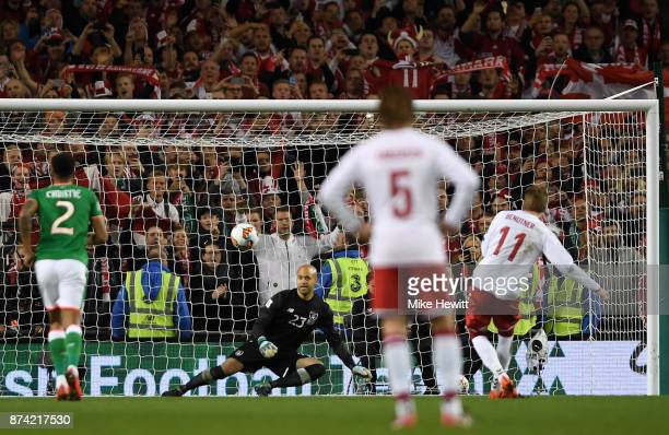Nicklas Bendtner of Denmark scores his sides fifth goal from the penalty spot past Darren Randolph of the Republic of Ireland during the FIFA 2018...