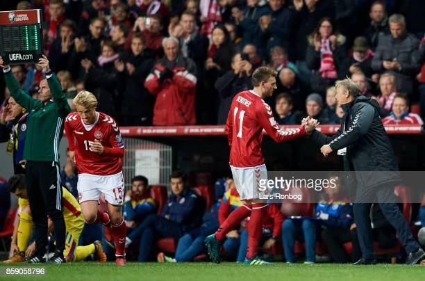 Nicklas Bendtner of Denmark shake hands with Age Hareide head coach of Denmark during the FIFA World Cup 2018 qualifier match between Denmark and...
