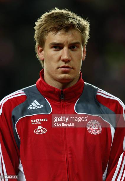 Nicklas Bendtner of Denmark stands for the national anthem during the FIFA 2010 group one World Cup Qualifying match between Denmark and Hungary at...
