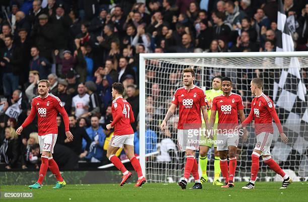 Nicklas Bendtner of Nottingham Forest and team mates look dejected after Nicklas Bendtner scores an own goal for Derby County's first during the Sky...