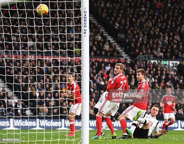 Nicklas Bendtner of Nottingham Forest scores an own goal for Derby County's first during the Sky Bet Championship match between Derby County and...