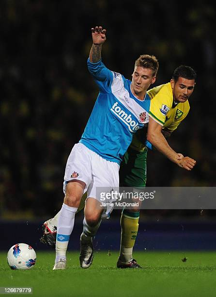 Nicklas Bendtner of Sunderland battles with Bradley Johnson of Norwich City during the Barclays Premier League match between Norwich City and...