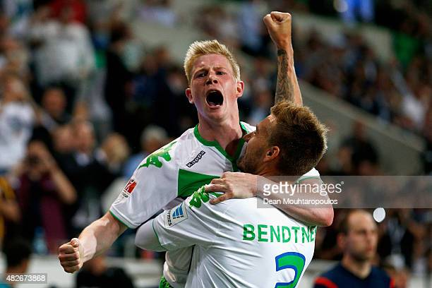 Nicklas Bendtner of VfL Wolfsburg celebrates scoring his teams first goal of the game with team mate Kevin De Bruyne during the DFL Supercup match...