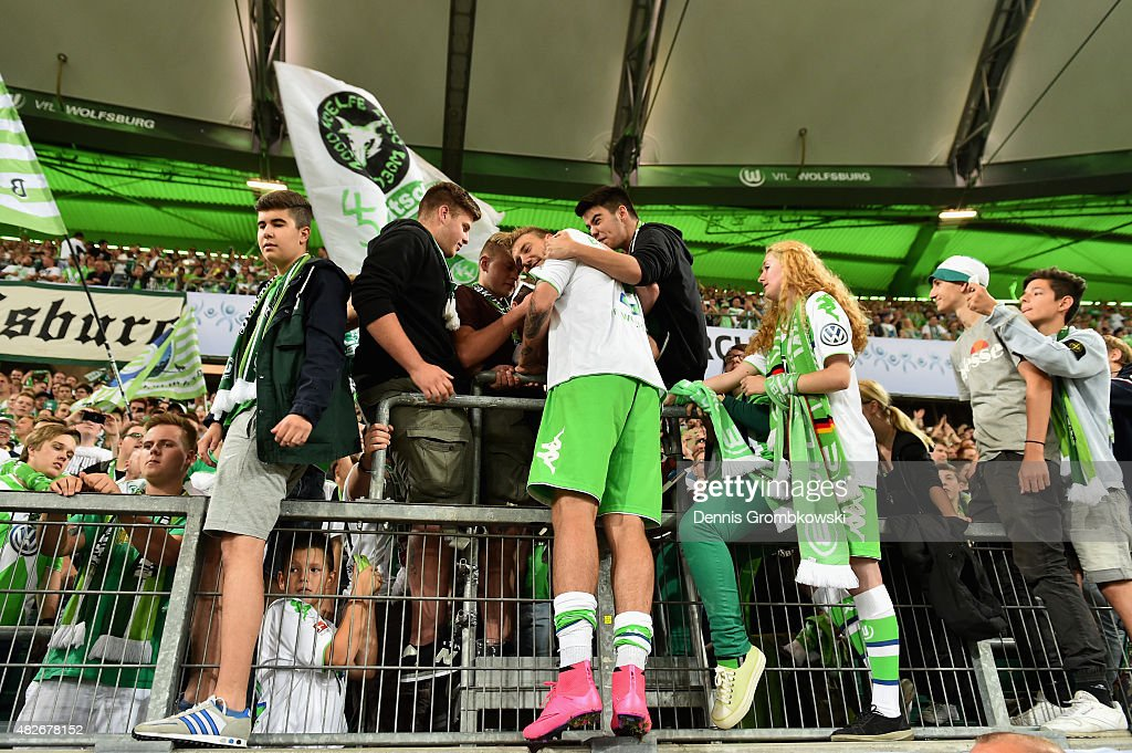 Nicklas Bendtner of VfL Wolfsburg celebrates with fans after the DFL Supercup 2015 match between VfL Wolfsburg and FC Bayern Muenchen at Volkswagen Arena on August 1, 2015 in Wolfsburg, Germany.