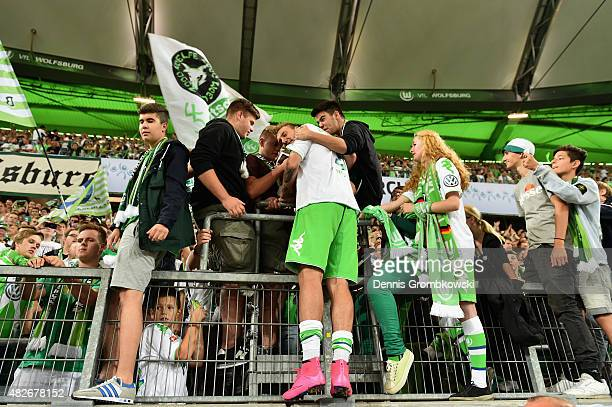 Nicklas Bendtner of VfL Wolfsburg celebrates with fans after the DFL Supercup 2015 match between VfL Wolfsburg and FC Bayern Muenchen at Volkswagen...