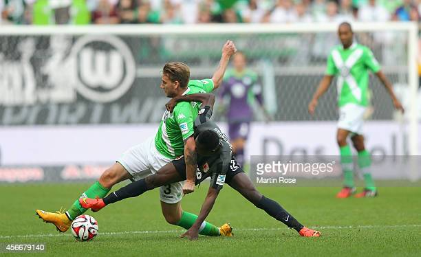 Nicklas Bendtner of Wolfsburg and Abdul Rahman Baba of Augsburg battle for the ball during the Bundesliga match between VfL Wolfsburg and FC Augsburg...