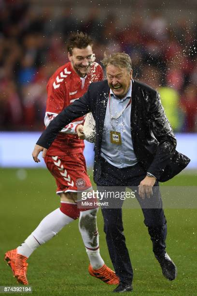 Nicklas Bentner of Denmark soaks coach Age Hareide after the FIFA 2018 World Cup Qualifier PlayOff Second Leg between Republic of Ireland and Denmark...