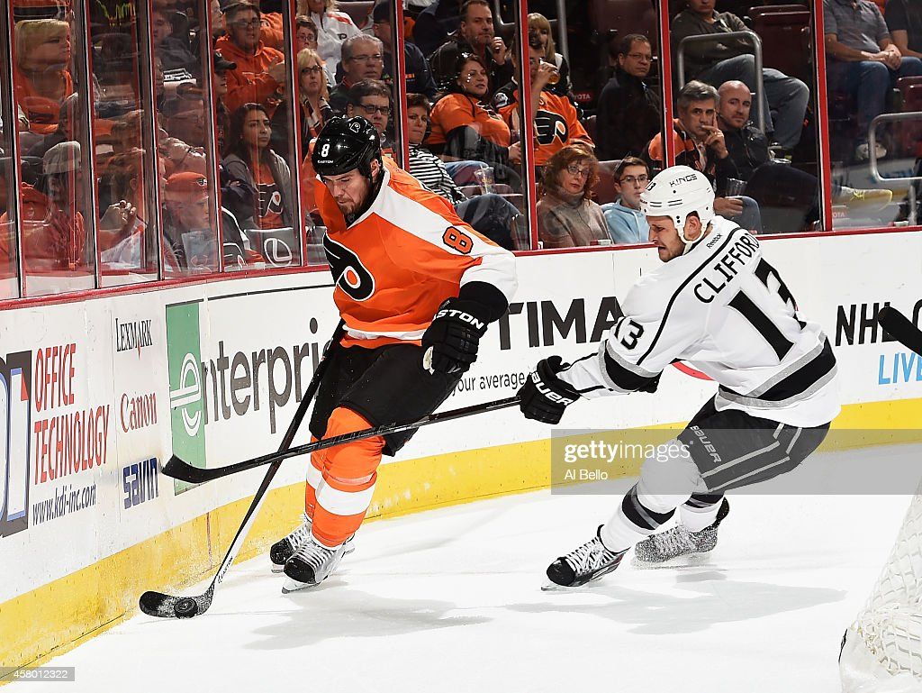 Nicklas Grossmann #8 of the Philadelphia Flyers skates with the puck as Kyle Clifford #13 of the Los Angeles Kings defends during their game at the Wells Fargo Center on October 28, 2014 in Philadelphia, Pennsylvania.