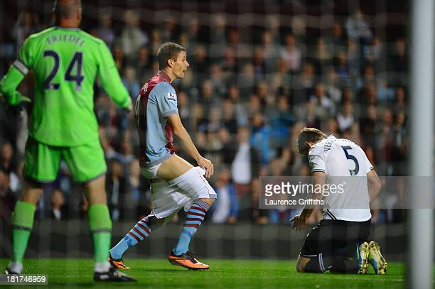 Nicklas Helenius of Aston Villa complains to the referee after having his shorts pulled down by Jan Vertonghen of Tottenham Hotspur during the...
