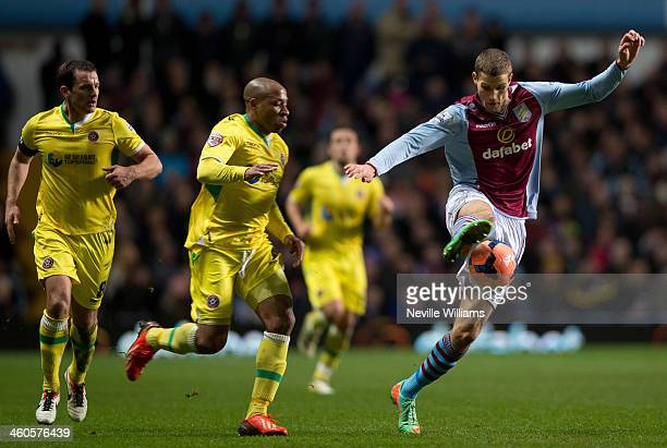 Nicklas Helenius of Aston Villa is challenged by Matt Hill of Sheffield United during the FA Cup Third Round match between Aston Villa and Sheffield...
