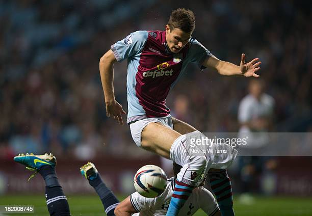 Nicklas Helenius of Aston Villa shorts are pulled down by Jan Vertonghen of Tottenham Hotspur during the Capital One Cup Third Round match between...