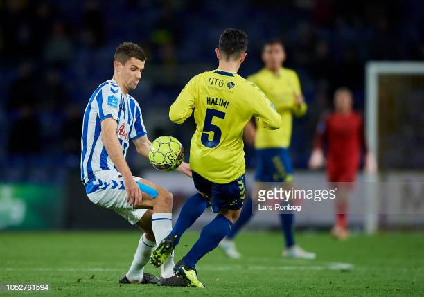Nicklas Helenius of OB Odense and Besar Halimi of Brondby IF compete for the ball during the Danish Superliga match between Brondby IF and OB Odense...