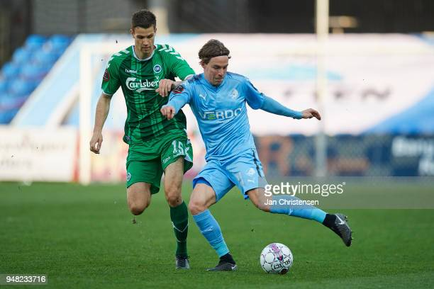 Nicklas Helenius of OB Odense and Erik Marxen of Randers FC in action during the Danish Alka Superliga match between Randers FC and OB Odense at...
