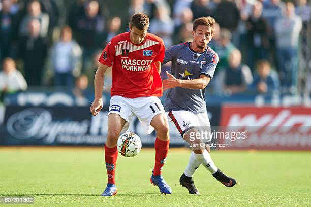 Nicklas Helenius of Silkeborg IF and Alexander Juel Andersen of AGF Arhus compete for the ball during the Danish Alka Superliga match between...