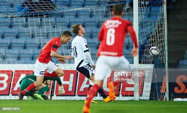Nicklas Helenius of Silkeborg IF scores the 30 goal against Goalkeeper Aleksandar Jovanovic of AGF Aarhus during the Danish Alka Superliga match...