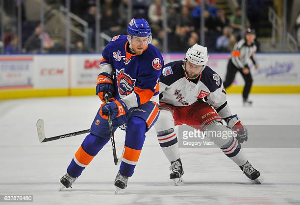 Nicklas Jensen of the Hartford Wolf Pack and Devon Toews of the Bridgeport Sound Tigers skate during the game at the Webster Bank Arena on January 27...