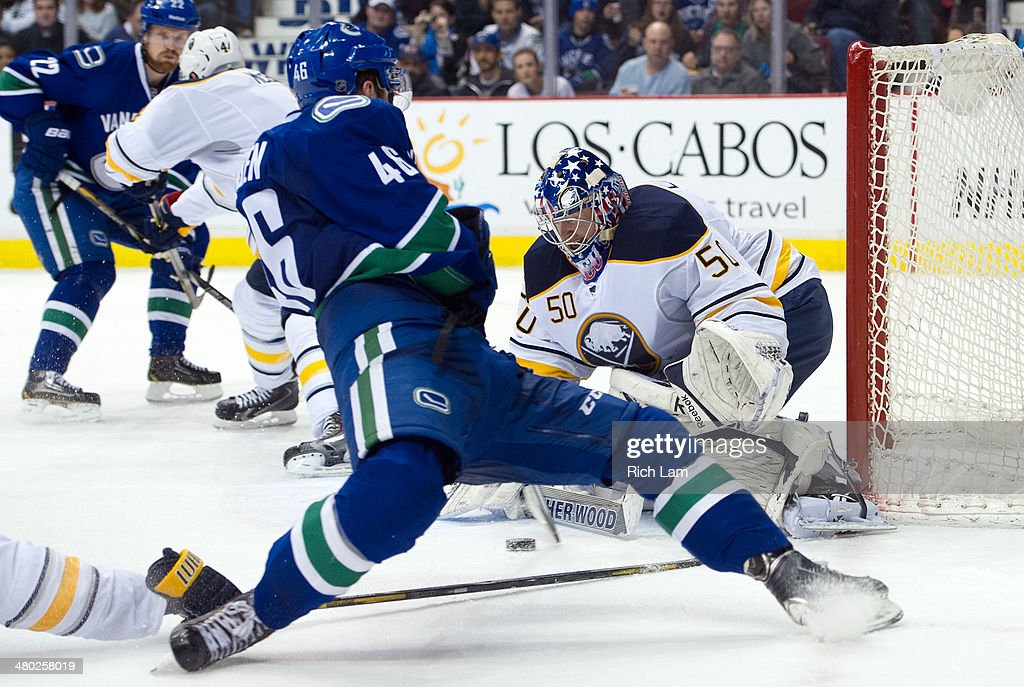 Nicklas Jensen #46 of the Vancouver Canucks gets a weak shot on goalie Nathan Lieuwen #50 of the Buffalo Sabres after getting tripped on the play during the second period in NHL action on March 23, 2014 at Rogers Arena in Vancouver, British Columbia, Canada.
