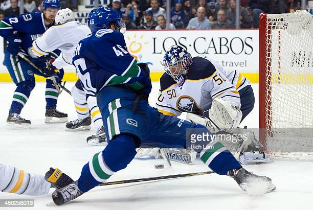 Nicklas Jensen of the Vancouver Canucks gets a weak shot on goalie Nathan Lieuwen of the Buffalo Sabres after getting tripped on the play during the...