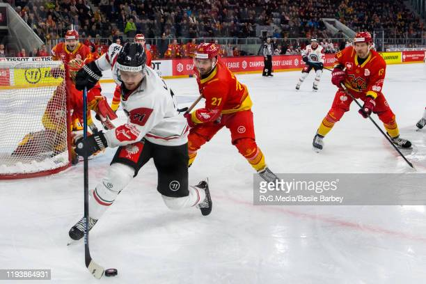 Nicklas Lasu of Frolunda HF controls the pucks in front of Jason Fuchs of EHC Biel during the second quarterfinals game between EHC BielBienne and...