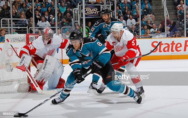 Nicklas Lidstrom and Jimmy Howard of the Detroit Red Wings follow the puck against Joe Pavelski and Manny Malhotra of the San Jose Sharks in Game...