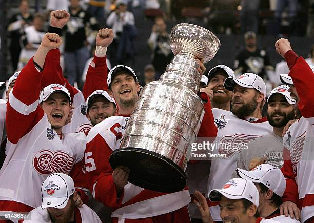 Nicklas Lidstrom and the Detroit Red Wings celebrate with the Stanley Cup after defeating the Pittsburgh Penguins in game six of the 2008 NHL Stanley...