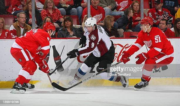 Nicklas Lidstrom of the Detroit Red Wings and teammate Valtteri Filppula of the Detroit Red Wings defend against Matt Duchene of the Colorado...