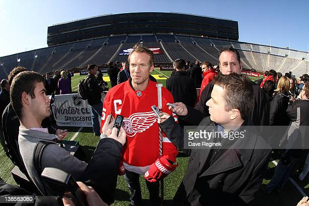 Nicklas Lidstrom of the Detroit Red Wings answers questions from the media during the NHL Winter Classic press conference at Michigan Stadium on...