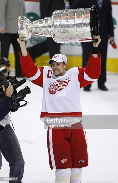 Nicklas Lidstrom of the Detroit Red Wings celebrates winning the Stanley Cup after beating the Pittsburgh Penguins 32 in game six of the 2008 NHL...