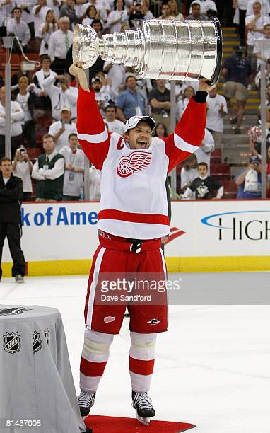 Nicklas Lidstrom of the Detroit Red Wings celebrates with the Stanley Cup after defeating the Pittsburgh Penguins in game six of the 2008 NHL Stanley...