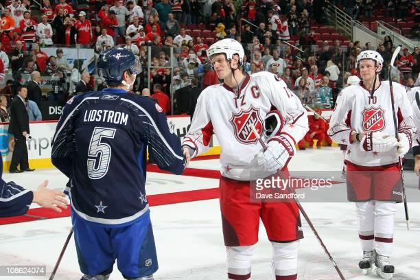 Nicklas Lidstrom of the Detroit Red Wings for team Lidstrom shakes hands with Eric Staal of the Carolina Hurricanes for team Staal after their 11-10...