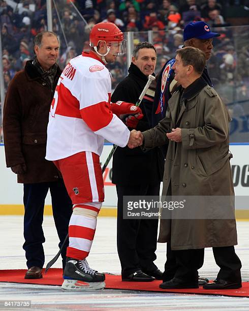 Nicklas Lidstrom of the Detroit Red Wings greets former Wing great Ted Lindsay before the NHL Winter Classic game against the Chicago Blackhawks on...