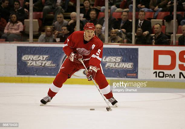 Nicklas Lidstrom of the Detroit Red Wings handles the puck against the Vancouver Canucks at Joe Louis Arena on January 26 2006 in Detroit Michigan...