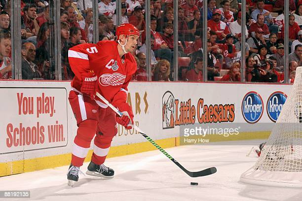 Nicklas Lidstrom of the Detroit Red Wings handles the puck against the Pittsburgh Penguins during Game Two of the 2009 Stanley Cup Finals at Joe...