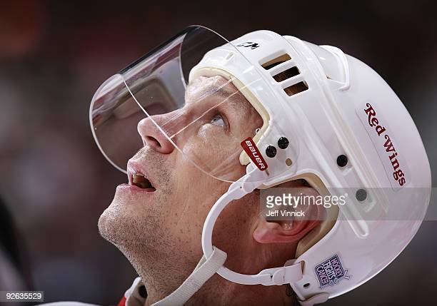 Nicklas Lidstrom of the Detroit Red Wings looks on from the bench during their game against the Vancouver Canucks at General Motors Place on October...