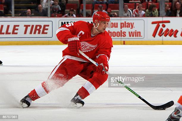 Nicklas Lidstrom of the Detroit Red Wings makes a hard turn with the puck during a NHL game against the New York Islanders on March 27 2009 at Joe...