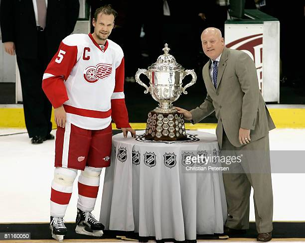 Nicklas Lidstrom of the Detroit Red Wings poses with the Clarence S Campbell Bowl and NHL Deputy Commissioner Bill Daly after defeating the Dallas...