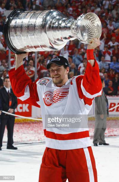 Nicklas Lidstrom of the Detroit Red Wings raises the Stanley Cup after defeating the Carolina Hurricanes during game five of the NHL Stanley Cup...